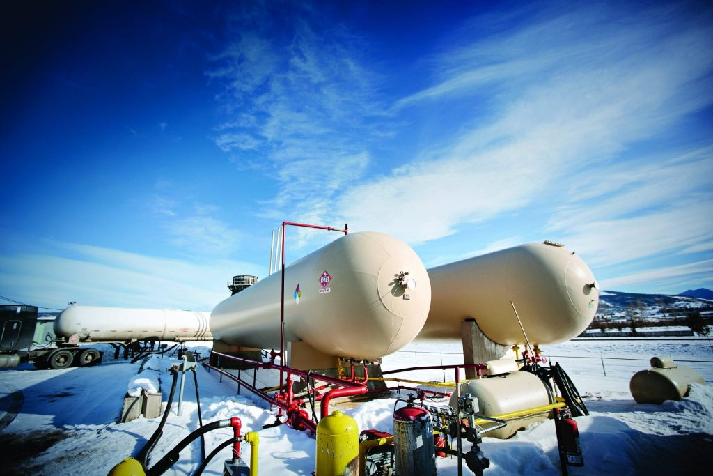 large outdoor propane tanks in snowy field
