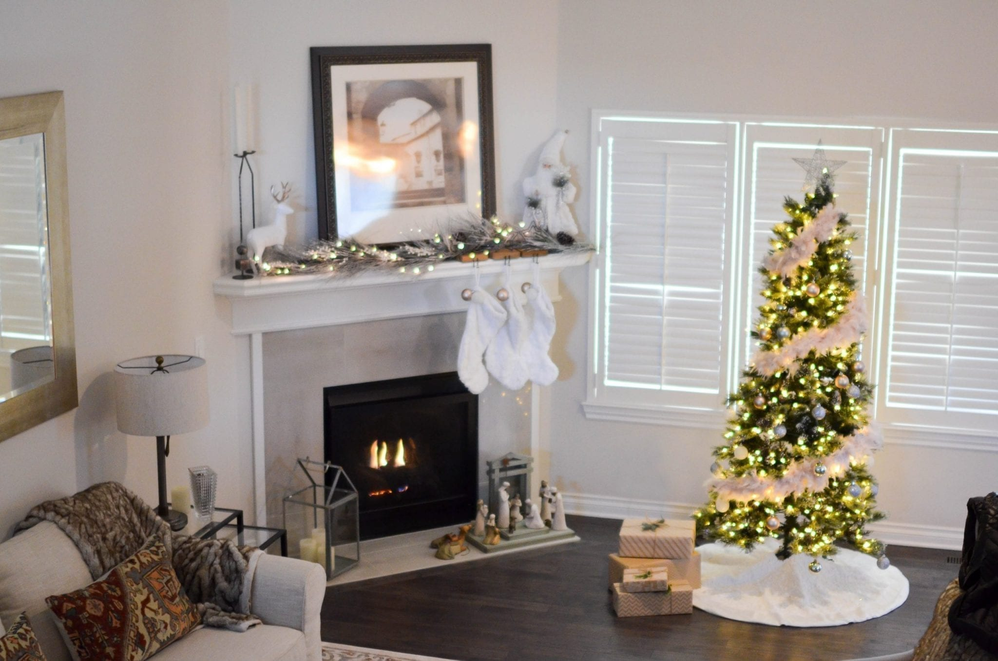 Canva - Green and White Pre-lit Pine Tree Near Fireplace Inside Well Lit Room
